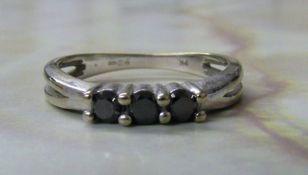 9ct white gold black diamond trilogy ring 0.30ct total ring size O weight 2.4 g