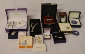 Various boxed gift items including necklaces, hip flask, earrings etc