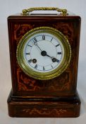 Small 19th century French table clock in an inlaid rosewood case. Back plate engraved Louis Et Miera