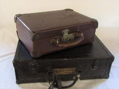 Small suitcase and a wooden suitcase