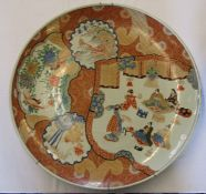 Extremely large 19th century Japanese charger with gilding on red oxide and cobalt blue depicting