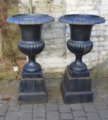 Pair of cast iron garden urns on bases H 110cm