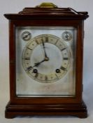 19th century bracket clock in a mahogany case with a silvered dial, bevelled glass side panels,