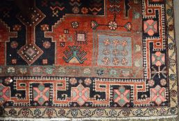 Red & blue ground Middle Eastern carpet 285cm by 163cm