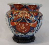 Japanese Imari jardiniere with raised bow decoration width 26cm  height 23cm