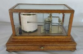 Manoah Rhodes & Sons Ltd Bradford oak cased barograph with bevelled glass panels and chart drawer