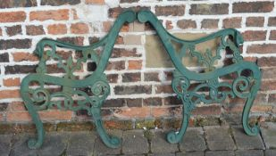 Pair of cast iron bench ends with lion head arms