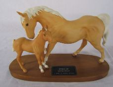 Beswick Palomino horse on foal 'Spirit of Affection' on wooden plinth L 32 cm
