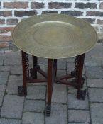Oriental brass top folding table