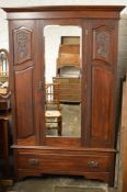 Carved late Victorian wardrobe with mirror door
