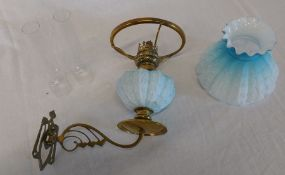 Victorian brass wall mounted paraffin lamp with blue glass paraffin reservoir , 2 chimneys and