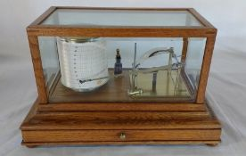 Manoah Rhodes & Sons Ltd Bradford oak cased hygrograph with bevelled glass panels and chart drawer