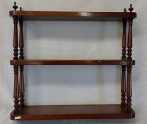 Victorian set of mahogany hanging open shelves with turned supports and urn finials width 53cm