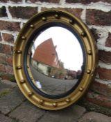Gilt framed circular mirror