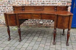 A fine Regency mahogany sideboard with ebony stringing & reeded columns on paw feet with bow fronted