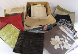 Box of fabric pieces suitable for craft work