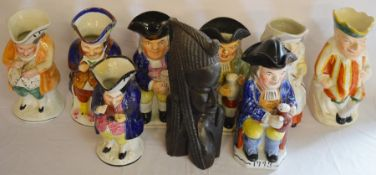 8 character jugs including Punch & Judy some repaired & a carved wood African tribal figure