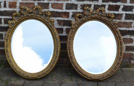 Pair of gilt oval wall mirrors
