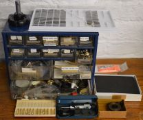 Small cabinet containing watch parts & spares, Moore & Wright gauge, watch straps etc