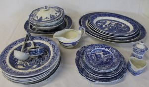 Selection of blue and white including Ironstone China bowls, Old Willow meat plates, Copeland