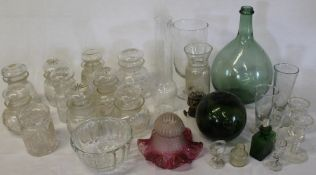 Selection of cut glass jam pots, celery vase, jelly mould, cranberry lampshade, measuring vessels,