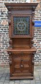 Early 20th century heavily carved oak cabinet with stained glass panel H 226 cm D 48 cm L 90 cm