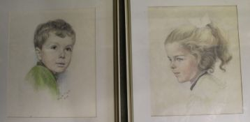 Pair of framed coloured pencil portraits of young boy and girl by German artist dated 1969