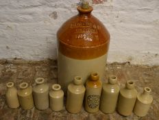 Various stoneware bottles including N E Knight Brigg