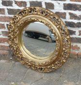 Gilt framed circular wall mirror