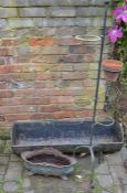 Cast iron pig trough, planter and wrought iron plant stand
