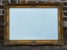 Ornate gilt frame wall mirror 93cm by 67cm