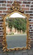 Large ornate gilt frame mirror Ht 144cm W 90cm