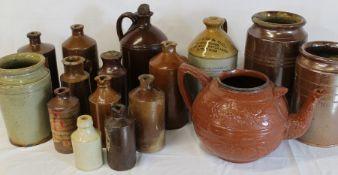 Selection of salt glazed stoneware including ink bottles, large teapot & Booth & Co Leeds flagon