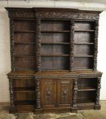 Large heavily carved oak late Victorian break front bookcase H 230 cm W 215 cm