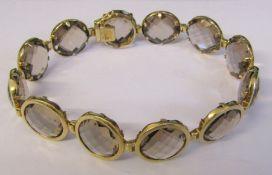 "9ct gold smokey quartz bracelet length 8"" total weight 27.6 g"