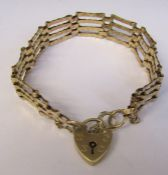 9ct gold gate bracelet with 9ct gold loveheart lock weight 10.3 g