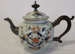 Chinese porcelain teapot with white metal spout, wooden handle & wooden and white metal finial (