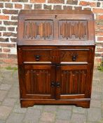 Oak bureau with linen fold panels