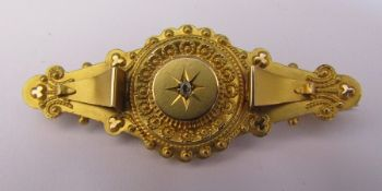 9ct gold brooch with central diamond accent length 4.5 cm weight 2.8 g