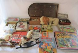 Selection of vintage toys including wooden jigsaws and bagatelle board