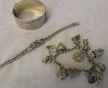 Silver charm bracelet (1.84 ozt), silver cuff bracelet (1.95 ozt) & white metal bracelet marked