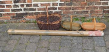 Various baskets & a roll of fabric