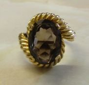 Tested as 9ct gold dress ring with 4ct smokey quartz stone size P total weight 6g
