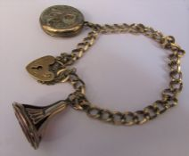 Tested as 9ct gold bracelet with 9ct gold locket and fob ('R' locket gold plated) total weight