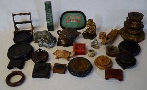 Various Oriental figures including a soapstone toad etc & wooden stands