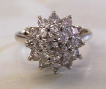 18ct white gold diamond cluster ring. Centre stone approx. 0.3ct total approx 1.3ct. Ring size P