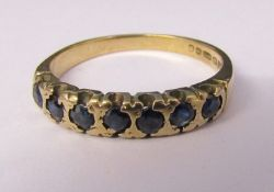9ct gold 7 stone sapphire eternity ring size P/Q weight 2.4 g