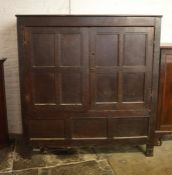 Early 18th century oak panelled cabinet on stile legs (one back leg missing) H 165 cm L 153 cm