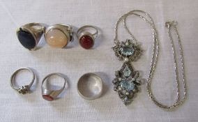 Various silver and white metal rings & a silver, pearl and marcasite pendant with blue stones on a