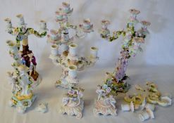 6 early 20th century porcelain figural candelabra with varying amounts of damage